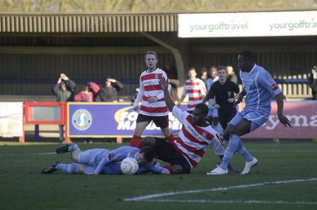 Crumbling: Kingstonian's latest league outing ended in a 2-0 home defeat to Billericay                SP81835