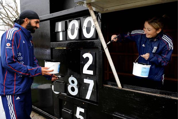 Surrey Comet: Mucking in: Monty Panesar and Rachel Edwards get stuck at Ashtead CC in 2009