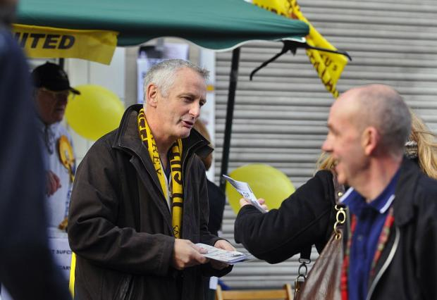 Drumming up support: Adrian Barry gets out into the community to spread the word of Sutton United before the 2011 FA Cup clash with Notts County