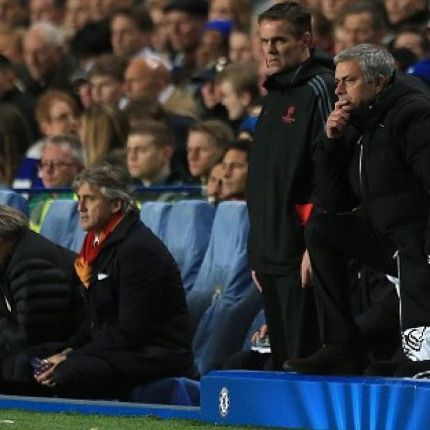 Surrey Comet: Chelsea manager Jose Mourinho, right, was delighted to see his side go through
