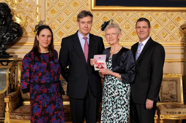 Kingston Age Concern chairman receives MBE from the Queen