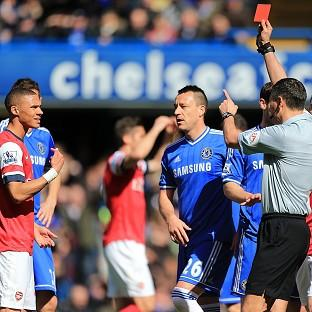 Andre Marriner, right, mistakenly sent off Kieran Gibbs, left, during Arsenal's 6-0 defeat to Chelsea on Saturday