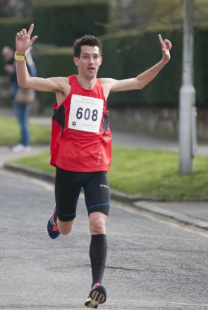 Winner: Kevin Quinn is about to take the tape at the Streets Ahead Croydon half-marathon                      All pictures: SP83959
