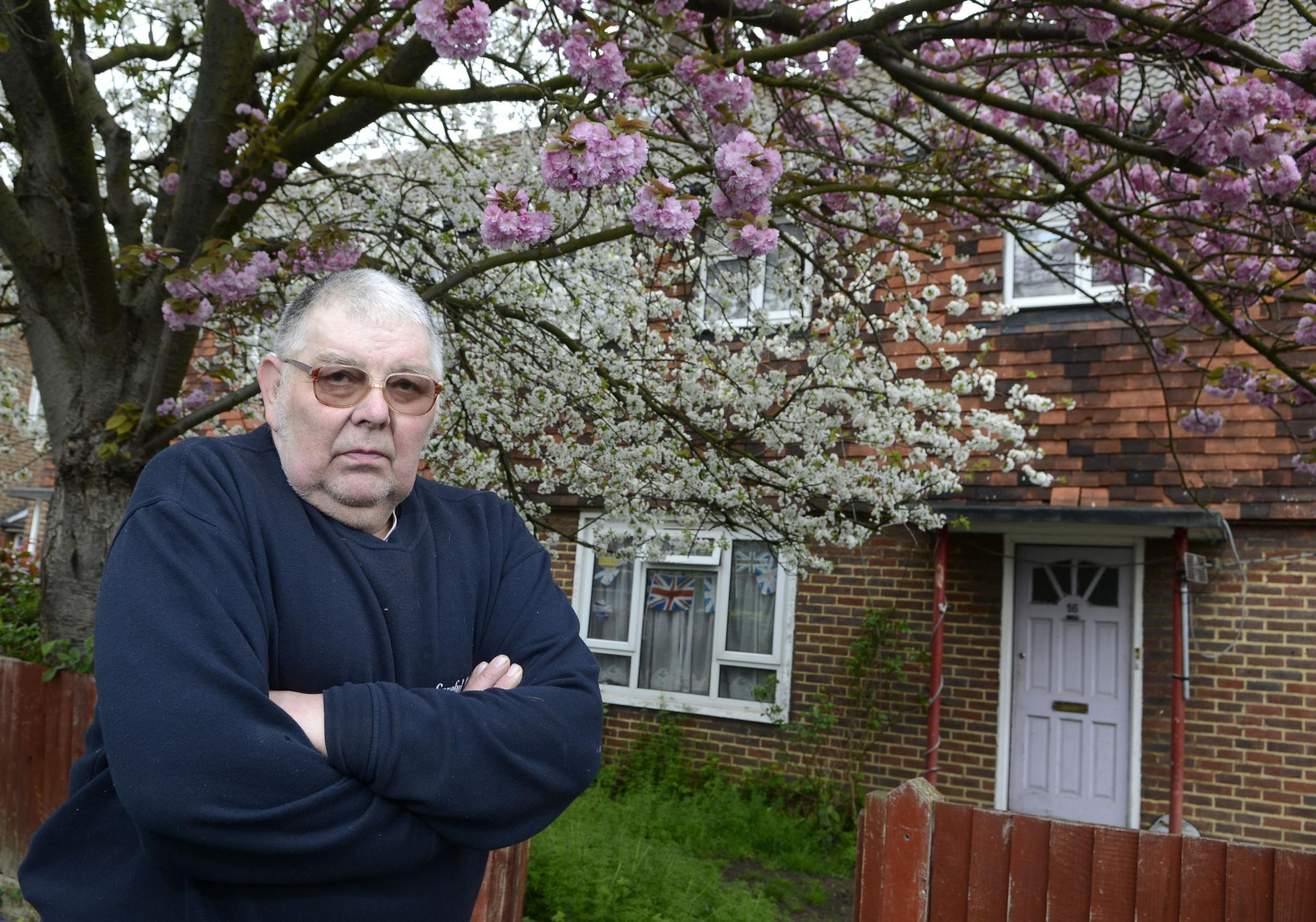Brian Smithers outside his front garden with the tree
