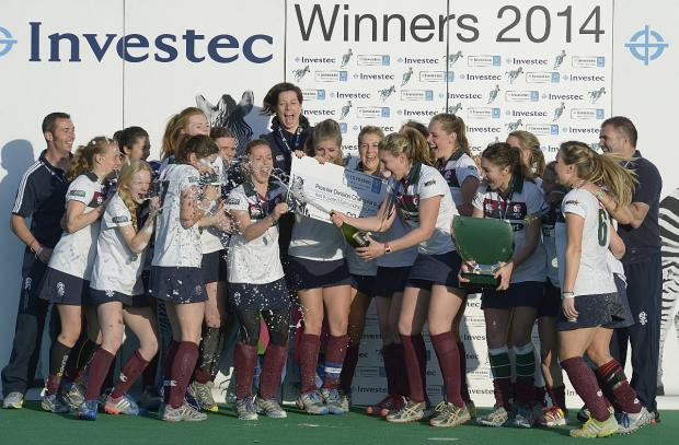 Surrey Comet: Champagne moment: Former England international Chloe Strong breaks open bubbly after Surbiton lifted the Women's Hockey League title
