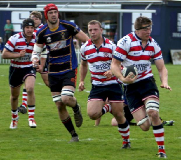 Get out my way: Tom Baldwin on the charge in Rosslyn Park's eight-try win over Cinderford on Saturday                All pictures: David Whittam