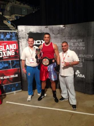 Winner: Joe Joyce flanked by his coaches