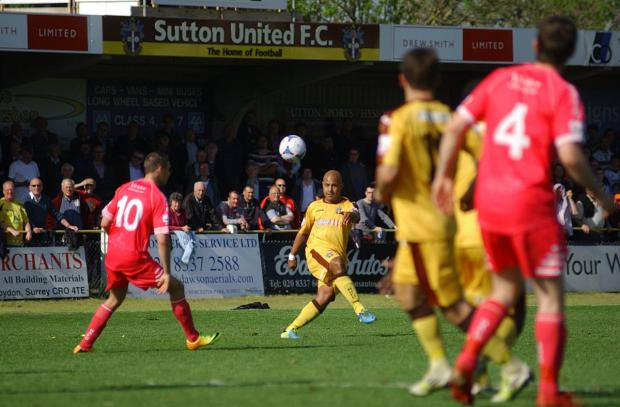 Surrey Comet: Not this time: Simon Downer and Sutton United face another season in the Skrill South after the disappointment of defeat on Saturday                   SP84841-14