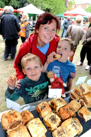 Pamela Rothwell, with Dylan, 5, and Charlie, 8, enjoying sausage rolls