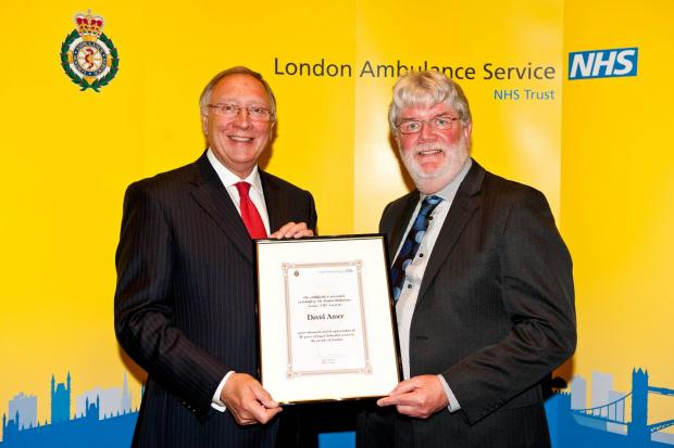 Amublanceman David Amer, 60, (right) being presented with a commendation by ambulance service chairman Richard Hunt