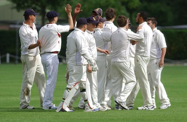 Celebrations: Spencer CC celebrate the fall of a Wimbledon wicket en route to a 93-run win over the reigning Premier Division champions                     SP81989
