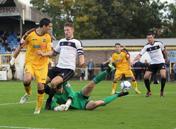 Swapping sides: Jamie Slabber scores the winner in Sutton United's 1-0 win over Bromley in October – next season, the striker will be in the white of Bromley after moving to Hayes Lane with team-mate Damian Scannell  	Picture: Paul Loughlin