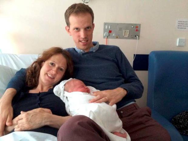 Surrey Comet assistant editor David Lindsell with wife Claire and son William