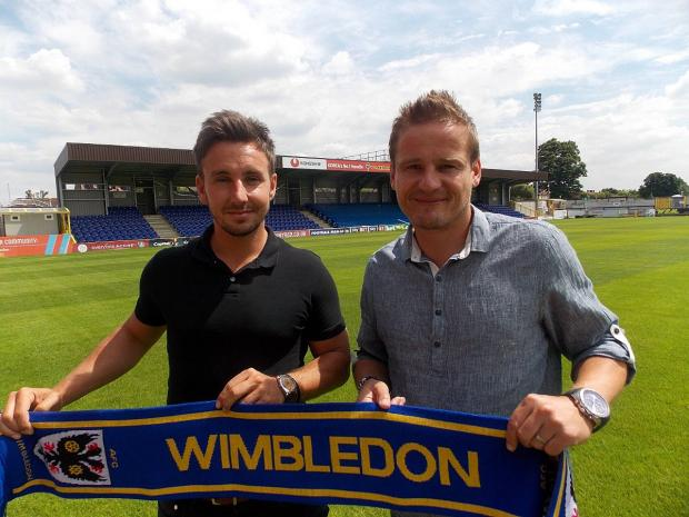 Welcome aboard: Matt Tubbs,left, has signed a one-year loan deal at AFC Wimbledon after Neal Ardley, right, finally got his man