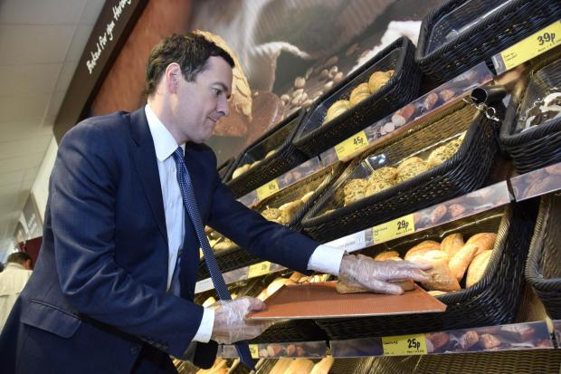Chancellor of the Exchequer George Osborne stacks shelves in Chessington