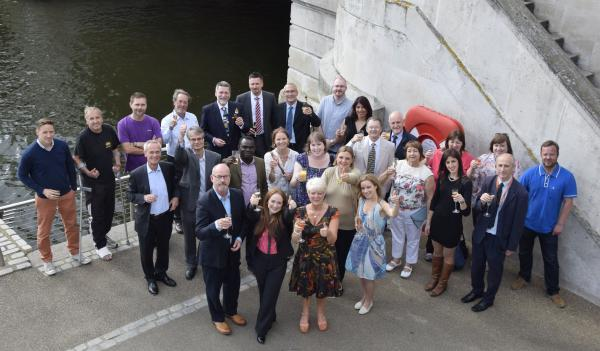 The Kingstonfirst team toasts the prospect of five more years in charge of the town centre