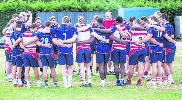 Back together: Rosslyn Park head coach Alex Codling, in the white cap, holds court as the pre-season training gets back underway               Picture: Charlie Addiman