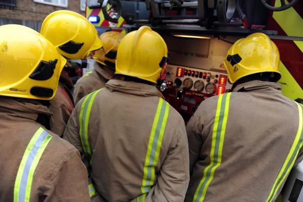 Firefighters strike while tackling large woodchip fire