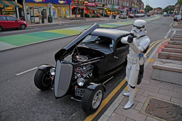 A Star Wars Imperial stormtrooper strikes back with a pose in Tolworth