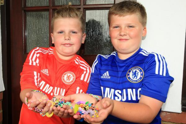 Billy May, nine, and brother Sonny, seven, have joined the loom band craze.