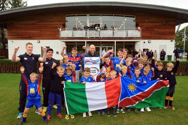 Great day: Cobham youngsters celebrate the news their club will