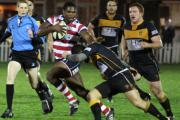 Stay there you: Rosslyn Park's Joe Ajuwa fends off an Esher tackle in last week's 27-10 win under lights