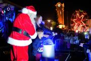 Santa with the iconic clocktower lit up behind. Pics by Jason EL Ayouby