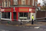 Police cordon off the area around KFC following a double stabbing in Worcester Park