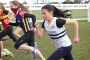 Pumping those arms: Croydon Harrier Jessica Moore in action at last weekend's Epsom Downs League meeting