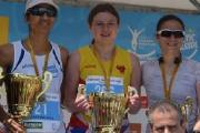 Drinks on you: Hercules Wimbledon's Caroline Jackson, centre, with her winner's trophy in Cyprus