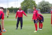 On duty: Hampton & Richmond Borough academy manager Peter Augustine, centre, gets his point across at Ipswich Town's Playford Road training centre earlier this month