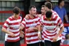 Happy returns: Former Ks midfielder Matt Somner, centre, is back in the game with Walton Casuals
