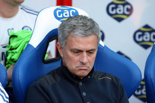 Cheer up: Chelsea boss Jose Mourinho has looked downbeat despite a first win of the season.