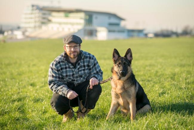 Andrew Eagle, 37, with his German Shepherd Leia at Epsom Downs