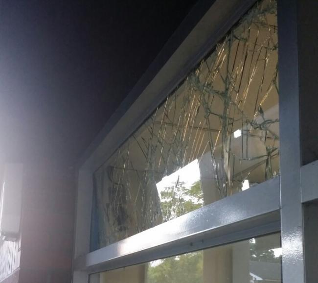 Thieves smashed the windows of the Hersham Road garage.