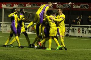 Sutton Common Rovers celebrate Matt Auletta's goal in the semi-final against Walton Casuals at Gander Green Lane