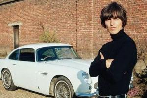 George Harrison and his Aston Martin DB5 outside Kinfauns