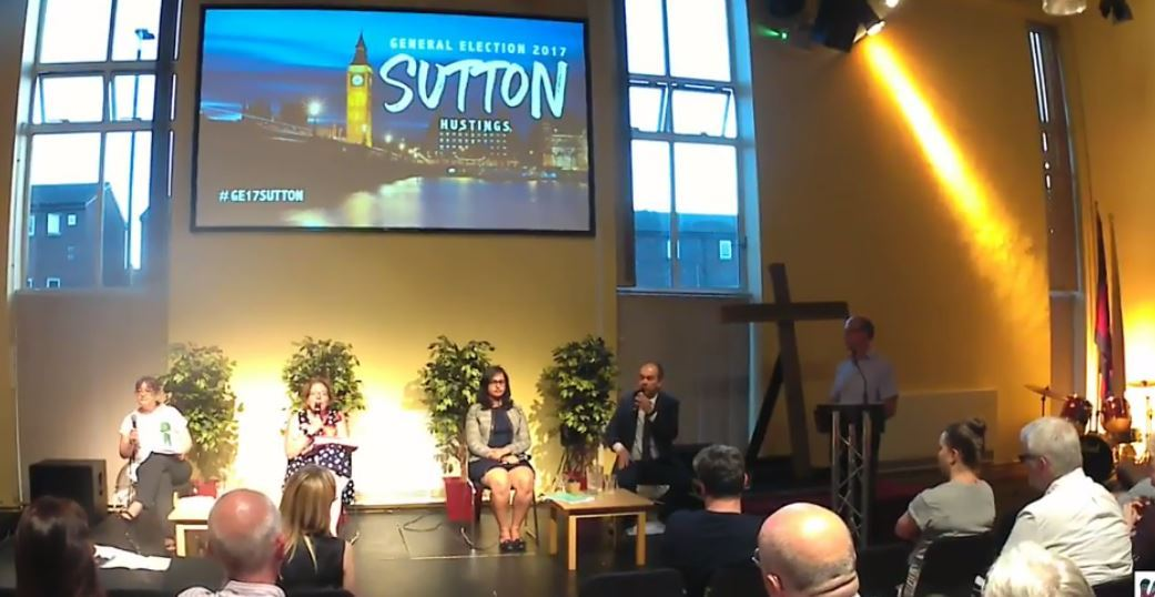 Paul Scully (holding microphone, far right) at the Sutton hustings last week