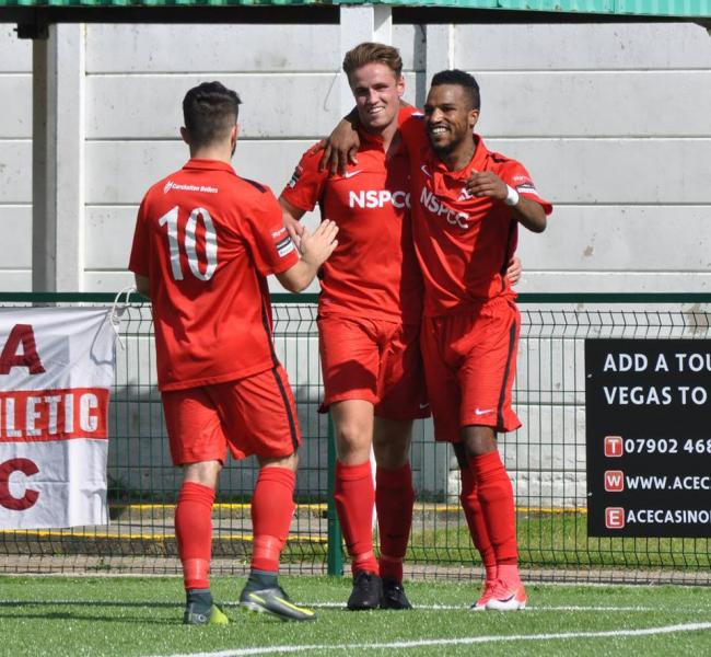 Carshalton Athletic celebrate going ahead against Ashford United on Saturday. Picture: Ian Gerrard