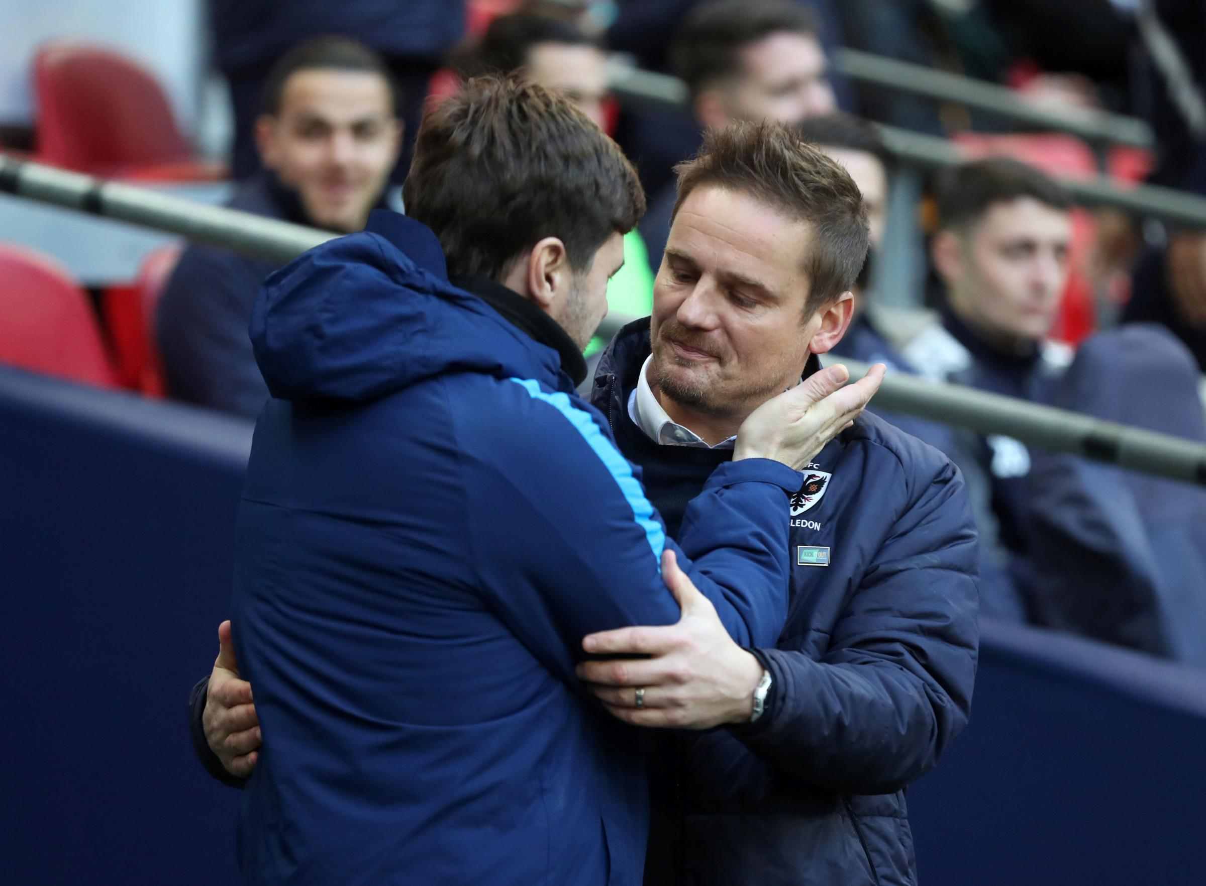 AFC Wimbledon boss Neal Ardley with Tottenham Hotspur manager Mauricio Pochettino. Photo: Adam Davy/PA Wire