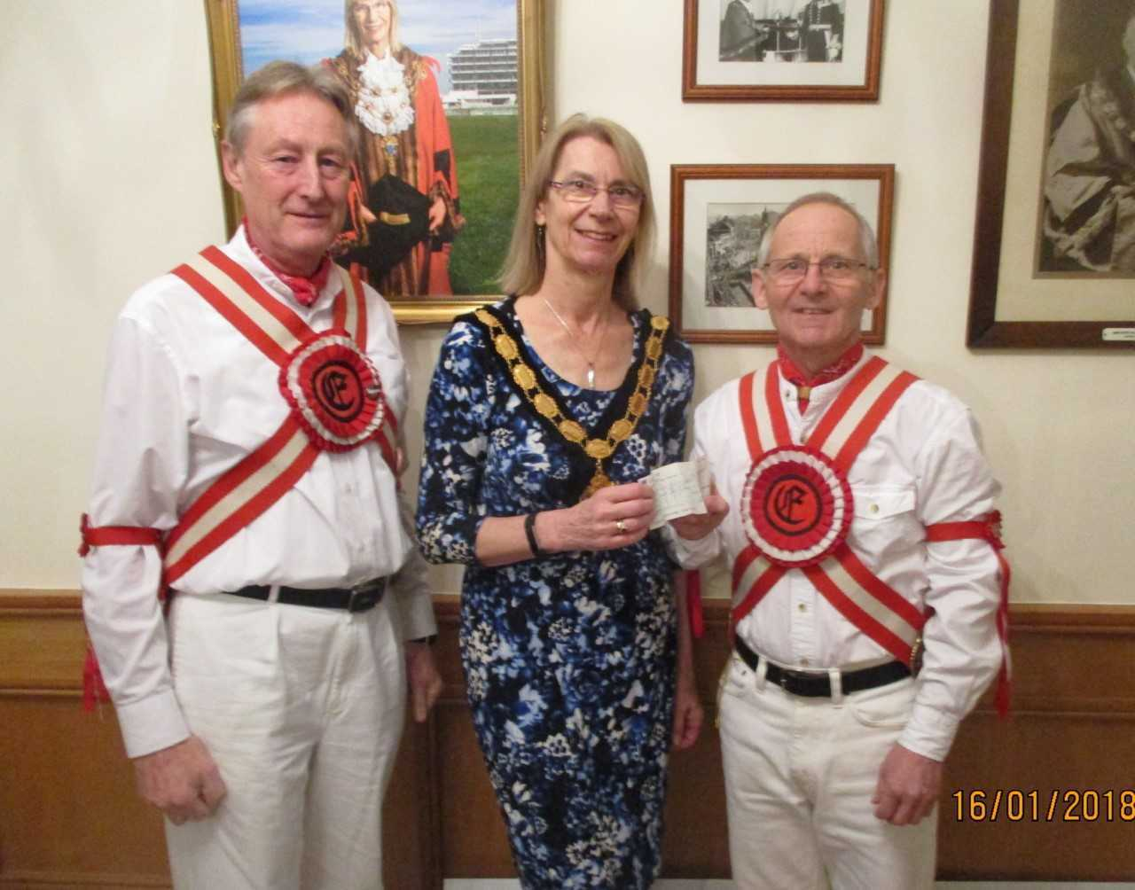 Mayor Liz Frost receiving cheque from, Morris Men Ray Watson and Alan Greenwood