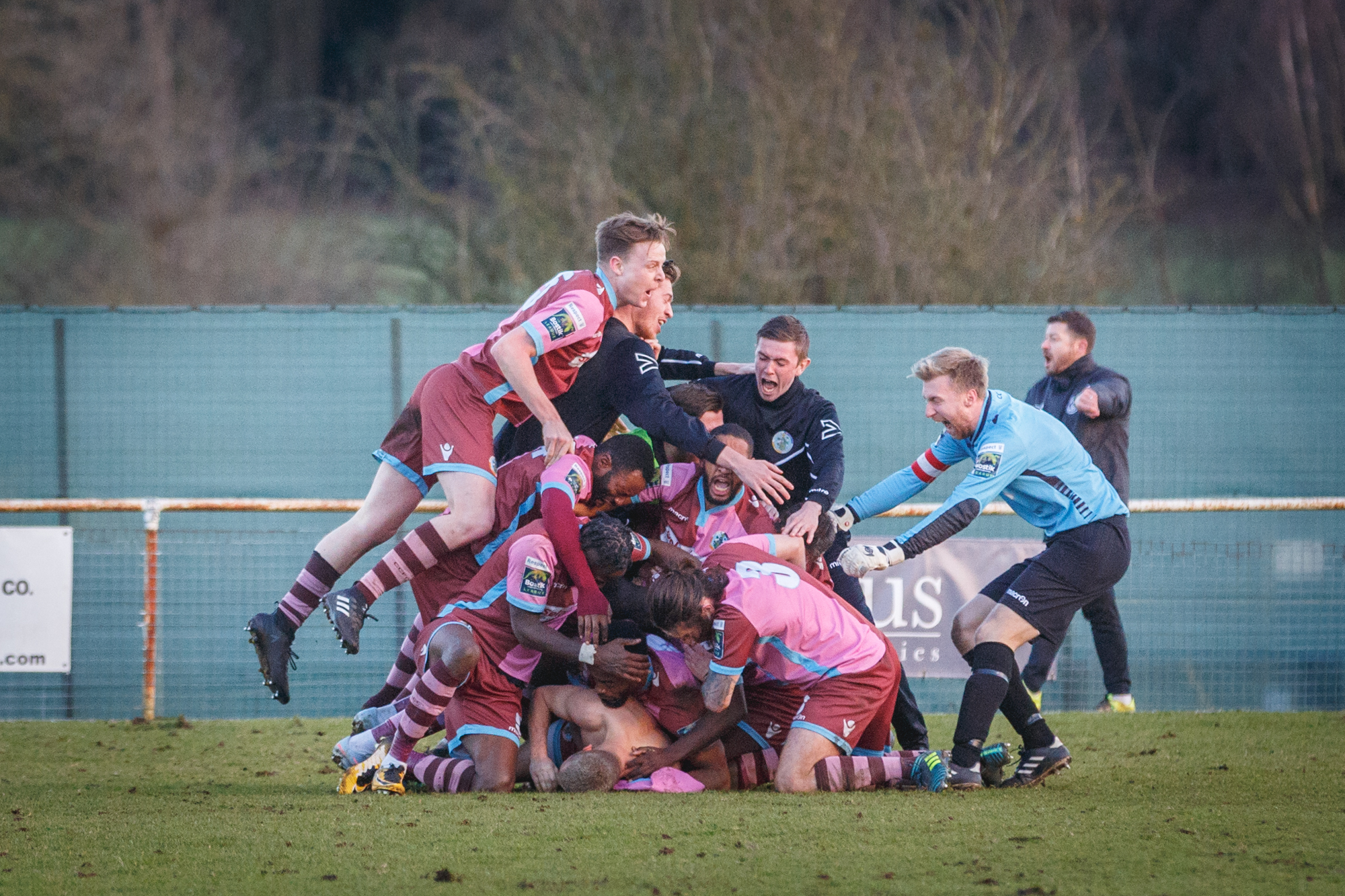 Corinthian-Casuals players celebrate Max Oldham's last-gasp winner at Chipstead on Saturday. Picture: Stuart Tree