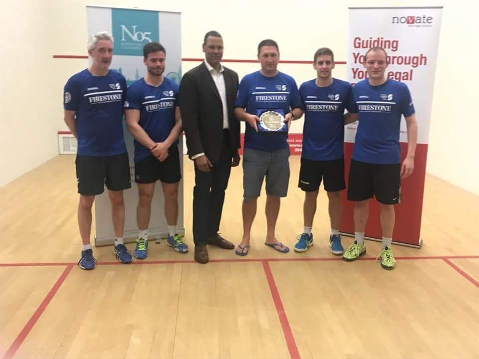 The Surbiton Racketball team being presented with the trophy