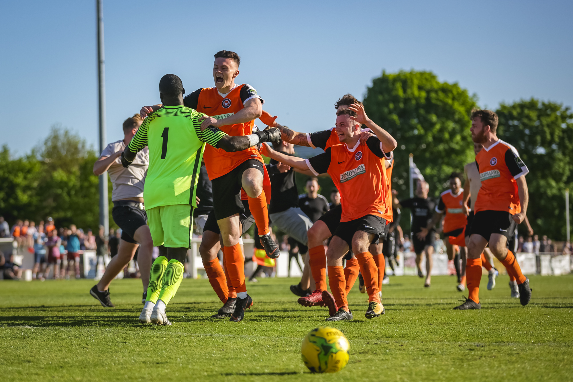 Walton Casuals players celebrate their penalty shoot-out win at Corinthian-Casuals. Picture: Stuart Tree