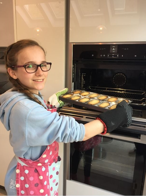 Young baker practises making Madeleine cakes ahead of Mortlake Bake Off 2018