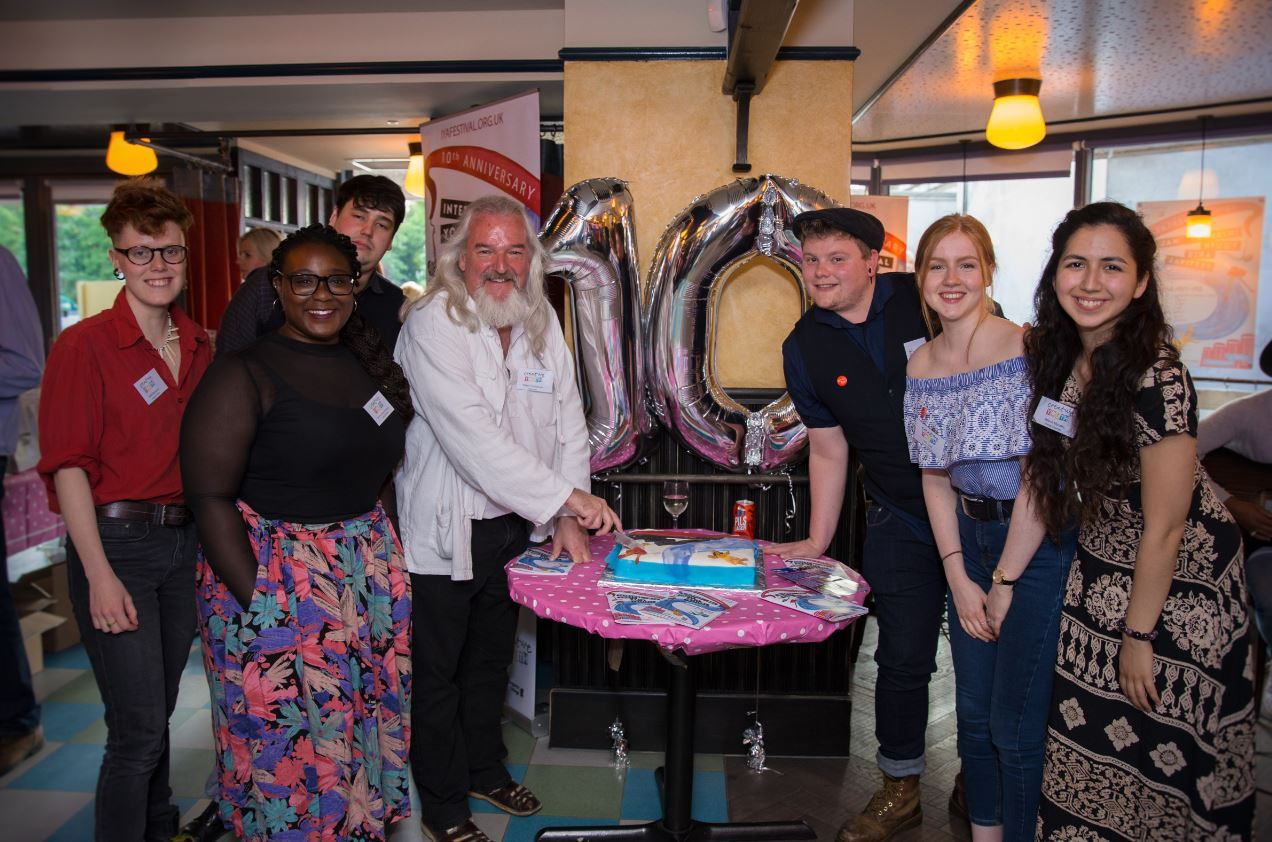 Robin Hutchinson and the Young Creative panel cut the cake at the IYAF 2018 launch (photo: Alexandra Tilling)