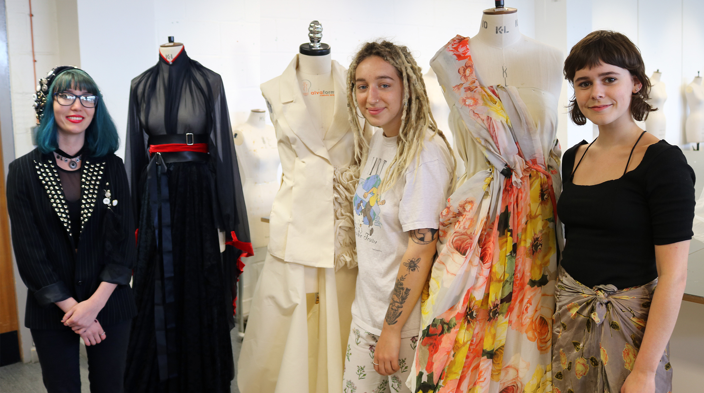 Emily Radforth, Sydney Cassidy and Hannah Creak with their royal wedding dress designs at Kingston University