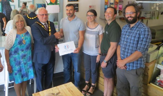 From left: Mayoress and Mayor of Epsom and Ewell Ann and Neil Dallen; Mike Georges & Carmen Ratoi of Zig Zag; Jonathan Lees of Epsom Refugees Network and Ben Margolis of City of Sanctuary