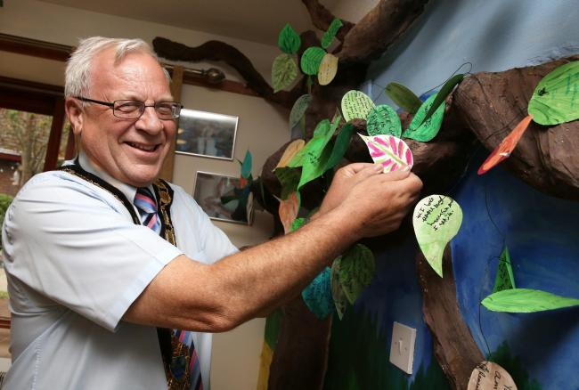 The Mayor of Epsom and Ewell, Councillor Neil Dallen with the 'tree of life' at Appleby House