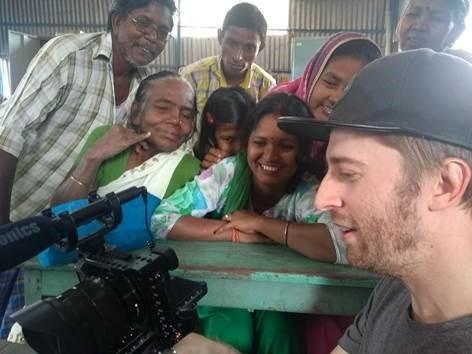 Surrey Comet: Photographer Jake Roos showing dance footage to patients at the Calcutta Rescue's Leprosy Clinic.